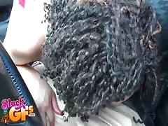 Curly-hair ebony swallowing his juicy dick with closed eyes